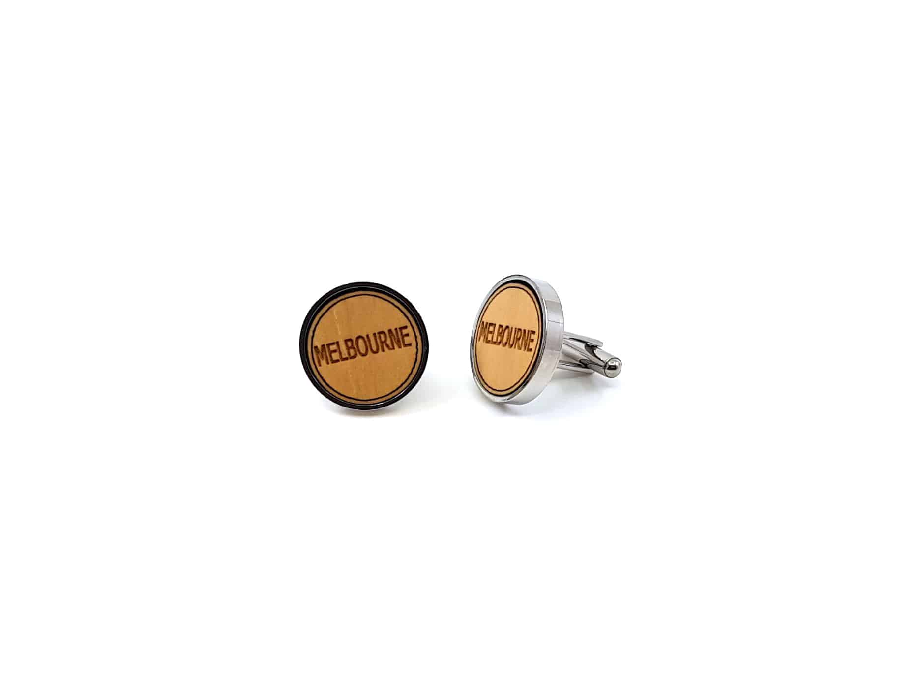 Round stainless steel cufflinks with a Eucalytpus wood insert and Melbourne word.