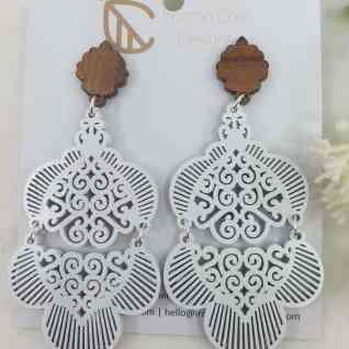 Morrocan inspired patterned earrings. Made from queensland walnut and hypoallergenic posts.