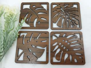 Monstera wooden coasters made from queensland walnut
