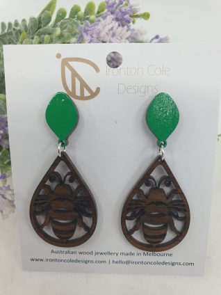 Bee earrings made from queensland walnut.